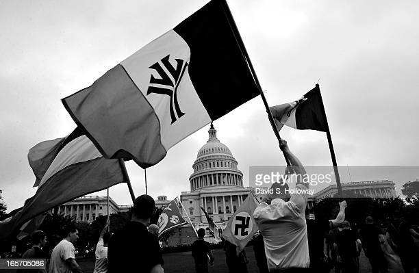 National Alliance members march on the yard of the Capitol Building along side other racists groups like skinheads and klansmen during a protest...