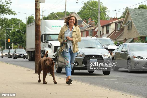 National anchor Lisa LaFlamme and her dog Toby head to vote Ontario Voters went to the polls today to elect new government June 7 2018