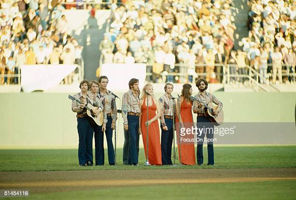 National Anthem Singers sing during the World Series featuring the New York Mets and the Oakland Athletics at OaklandAlameda County Coliseum in...