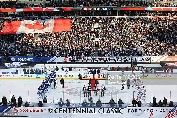 TORONTO ON JANUARY 1 National anthems as the Toronto Maple Leafs play the Detroit Red Wings alumni in the Centennial Classic at Exhibition Stadium in...