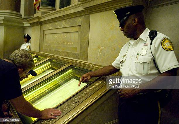 National Archives Special Police Officer Euril W Perry discusses the Constitution with a tourist at the National Archives on July 27 2012 in...