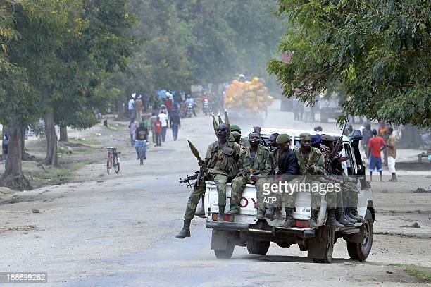 FARDC national army troops patrol in Kiwanja a town around 20 kilometres away from the fighting between army troops and rebels on November 2 2013 The...