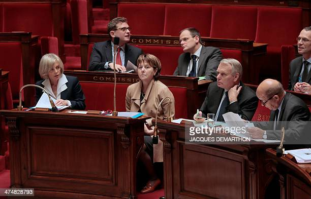 National Assembly members Elisabeth Guigou and Patricia Adam French Prime Minister JeanMarc Ayrault and French Defence Minister JeanYves Le Drian...