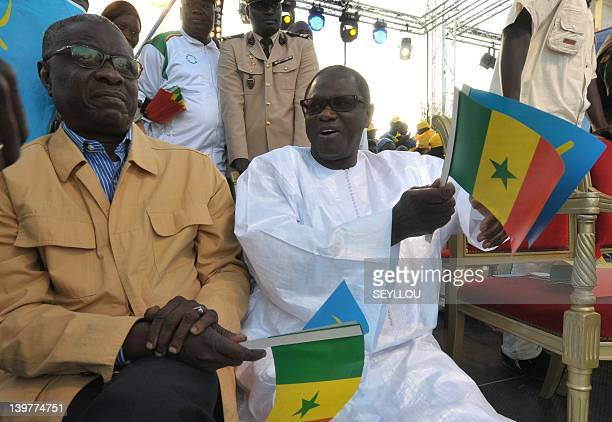 National assembly president Mamadou seck and Senate president Pape Diop hold election paraphernalia stand during a final campaign rally of Senegal's...