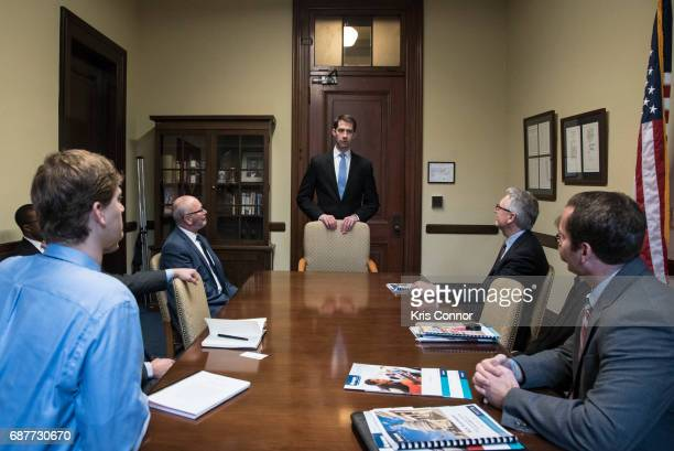 National Association of Music Merchants President Joe Lamond with other NAMM members speak with Sen Tom Cotton during 'NAMM VH1 And CMA Day Of Music...