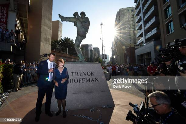 National Baseball Hall of Fame pitcher Trevor Hoffman poses for a photo with his mother Mikki Hoffman next to his statue before a baseball game...