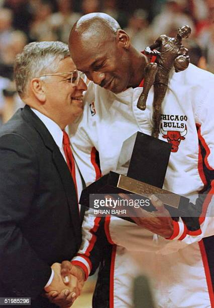 National Basketball Association Commisioner David Stern congratulates Chicago Bulls guard Michael Jordan during the 1996 NBA Most Valuable Player...