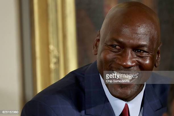 National Basketball Association Hall of Fame member and legendary athlete Michael Jordan smiles before being awarded the Presidential Medal of...