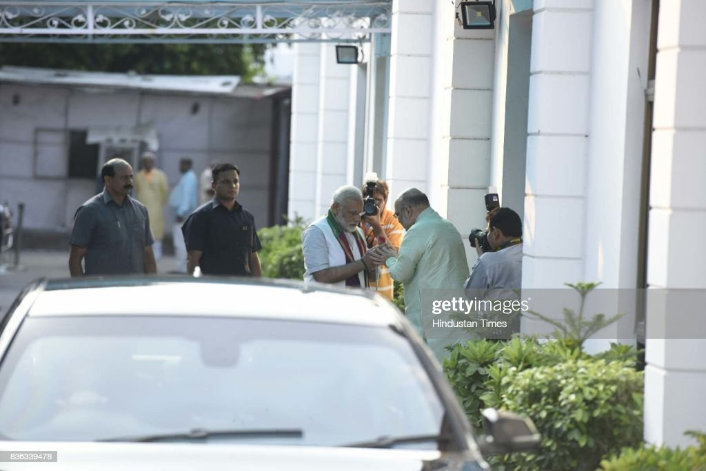 National BJP President Amit Shah welcomes PM Narendra Modi during a meeting with BJP Chief Ministers at BJP office on August 21, 2017 in New Delhi, India.