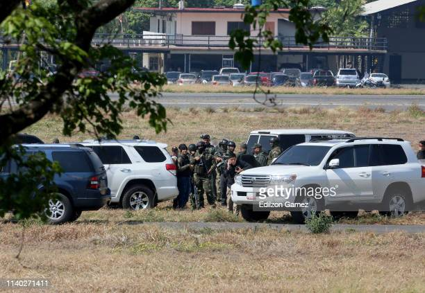 National Bolivarian Armed Forces of Venezuela stand guard of the air force base La Carlota on April 30 2019 in Caracas Venezuela Through a live...