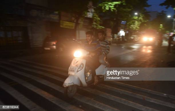 National Boxing Medallist and fourtime state gold medallist Akshay Mare and his elder brother Tushar Mare ride on two wheeler with bundles of...