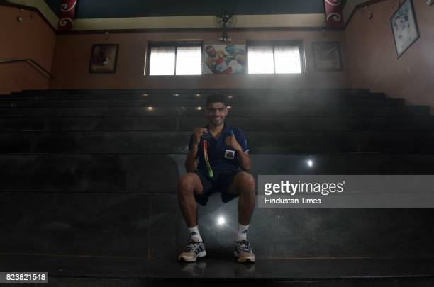 National Boxing Medallist and fourtime state gold medallist Akshay Mare poses for photo with his bronze medal at Lahuji Vastad Salve Boxing Training...