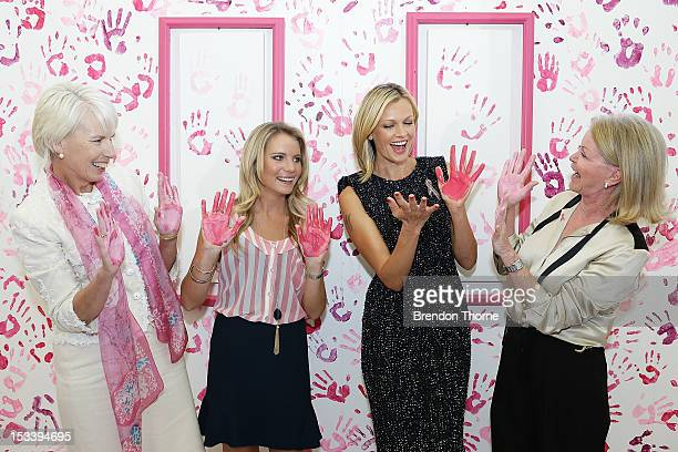 National Breast Cancer Foundation patrons Westpac CEO Gail Kelly Anne Kelly Sarah Murdoch and Carol O'Hare share a joke whilst displaying their hands...