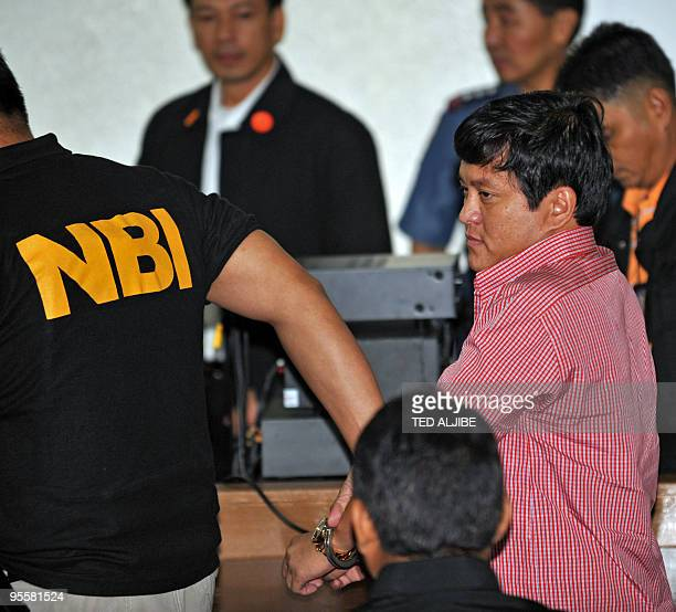 National Burueau Investigation agents escort Andal Ampatuan Jnr the prime suspect in the country's worst political massacre inside a court at the...