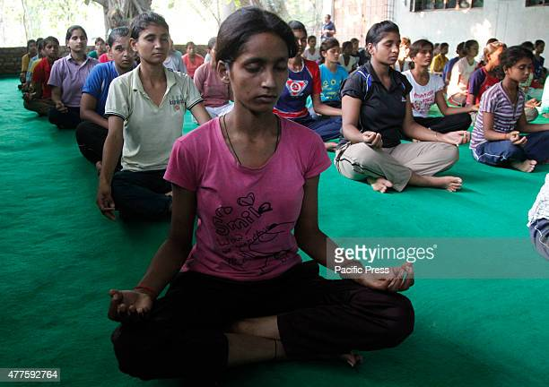 National Cadet Crops students perform yoga conducted by Kriyayog Sansthan ahead of World Yoga day in Allahabad