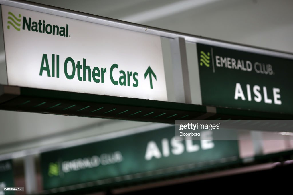 National Car Rental System Inc Signage Is Displayed At A Garage