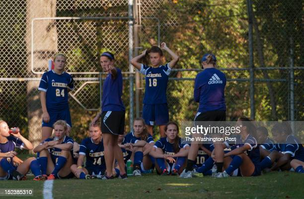 National Cathedral School's Head Soccer Coach Danielle Malagari talks with her team during halftime in their game against Sidwell on Wednesday...