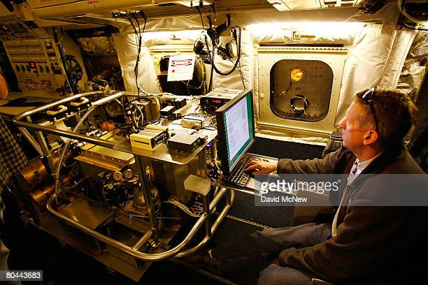 National Center for Atmospheric Research scientist Andy Weinheimer makes final adjustments to equipment for measuring active nitrogen in ozone aboard...