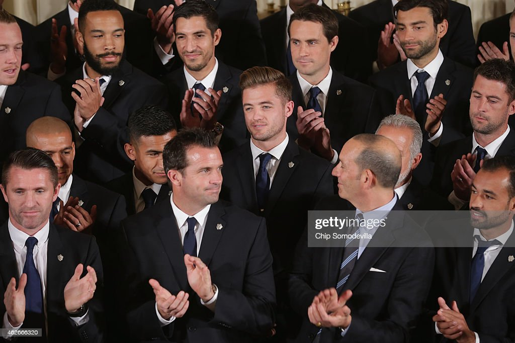 National champions Los Angeles Galaxy player Robbie Rogers is applauded by his teammates after being recognized by U.S. President Barack Obama for being the first openly gay player in Major League Soccer in the East Room of the White House February 2, 2015 in Washington, DC. Obama simultaneously hosted the National Hockey League champions Los Angeles Kings. Both teams are owned in part by billionaire and The Weekly Standard publisher Philip Anschutz.