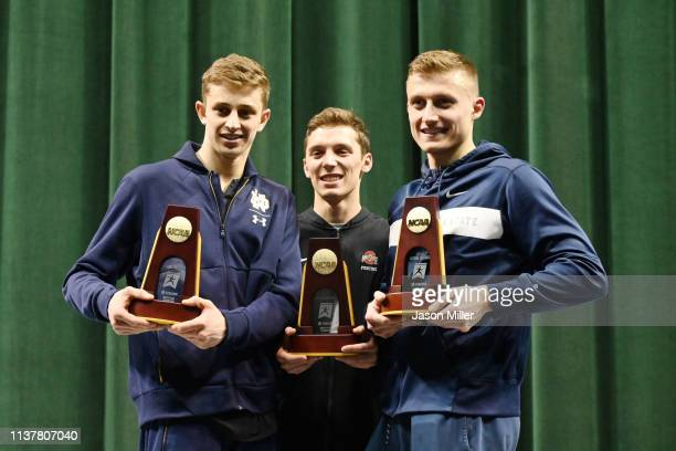 National Champions Nick Itkin of Notre Dame Oliver Shindler of Ohio State and Karol Metryka of Penn State stand with their trophies during the...