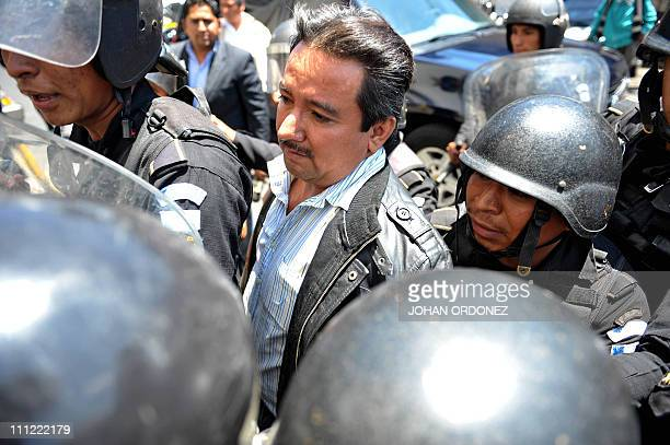National civil police special forces agents escort alleged drug trafficker Juan Ortiz aka Chamale to court in Guatemala City on March 30 2011 Ortiz...