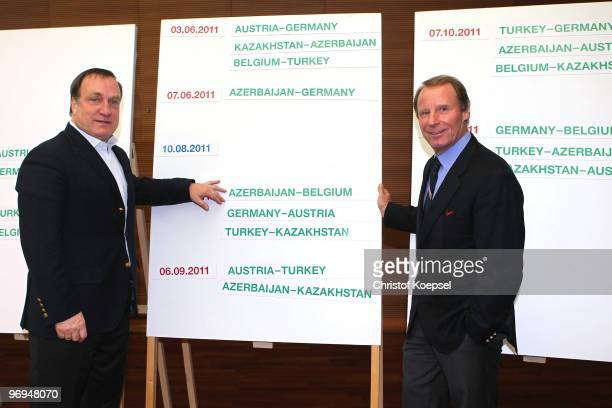National coach Dick Advocaat of Belgium and national coach Berti Vogts of Azerbaijan pose at the schedule during the meeting of the Euro 2012...