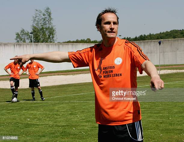 U18 national coach Heiko Herrlich gives instructions to prisoners during a training session during the youth inmate football program of the German...