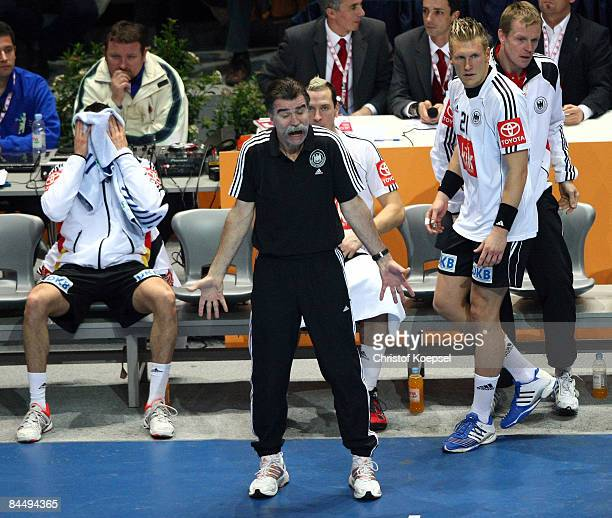 National coach Heiner Brand of Germany argues after a referee decision during the Men's World Handball Championships main round match group two...
