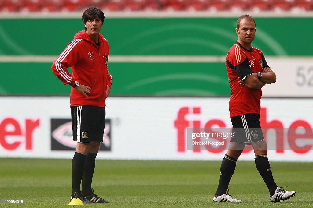 National coach Joachim Loew and assistant coach Hansi Flick attend a training session of the German National football team at Mercedes-Benz Arena on August 8, 2011 in Stuttgart, Germany. Germany will play a friendly match against Brazil at Mercedes-Benz Arena on August 10, 2011 in Stuttgart, Germany.