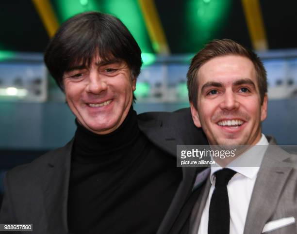National coach Joachim Loew and former national player Philipp Lahm pose at the extraordinary federal conference of the German Football Association...