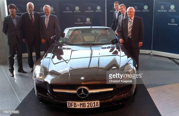 National coach Joachim Loew Dieter Zetsche chairman of the board of MercedesBenz Joachim Schmidt distribution and marketing manager of MercedesBenz...