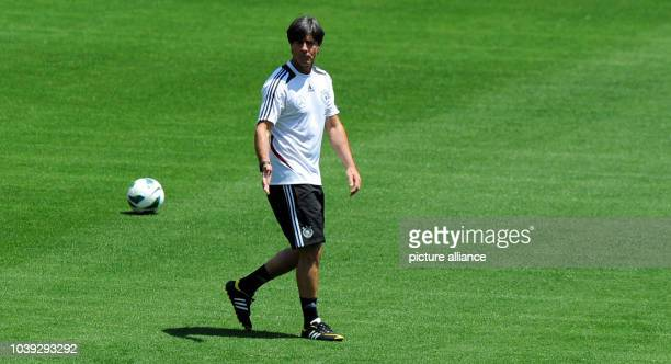 National coach Joachim Loew observes the final training of German national soccer team in Robert F Kennedy Memorial Staion in Washingtonm USA 01 June...