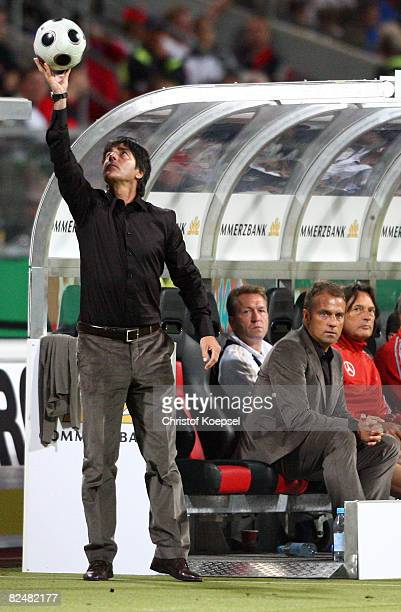 National coach Joahcim Loew of Germany juggles with the ball during the international friendly match between Germany and Belgium at the easyCredit...