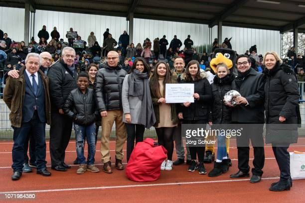 National coach Martina VossTecklenburg state secretary Serap Güler and DFB Vice President Peter Frymuth hand out a cheque during the U17 Girl's...