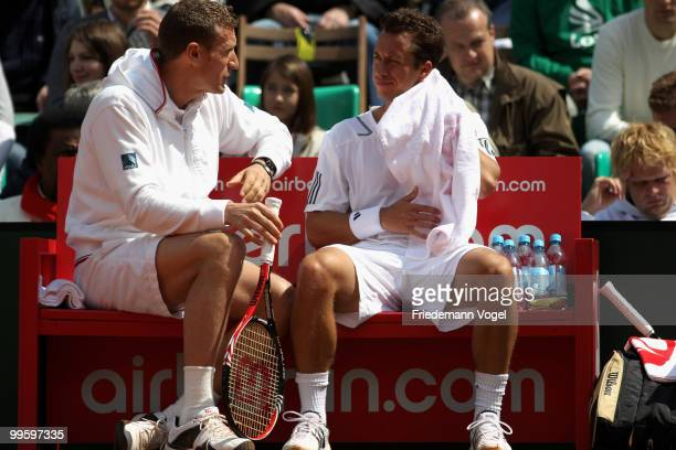 National coach Patrick Kuehnen and Philipp Kohlschreiber of Germany look on during day one of the ARAG World Team Cup at the Rochusclub on May 16...