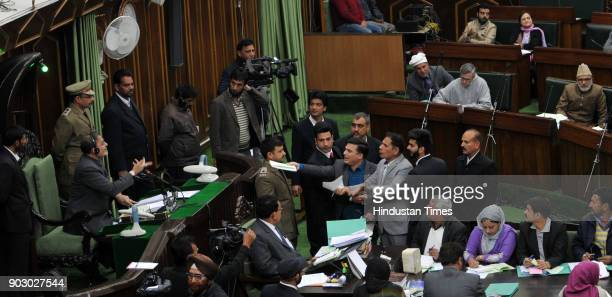National Conference and Congress MLA's protesting inside the JK Legislative assembly during the budget session on January 9 2018 in Jammu India