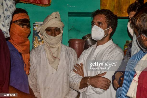 National Congress leader Rahul Gandhi speaks with relatives of the 19-year-old woman allegedly gang-raped and killed by four men in Bool Garhi of...
