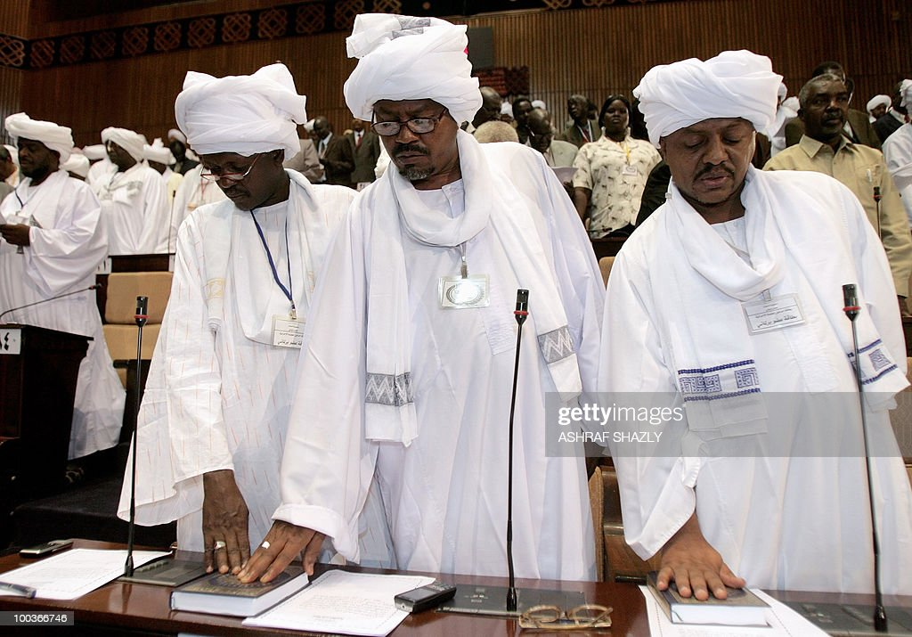 National Council members place their right hands on the Muslim religious book or Koran during the first gathering of Parliament since national elections in Khartoum on May 24, 2010. Sudan's new parliament meets for the first time since the April legislative elections to elect a new speaker. The elections, the first multi-party polls in the war-ravaged country since 1986, were replete with technical problems, fraud charges and opposition boycotts according to the US-based Carter Centre that monitored the polls.