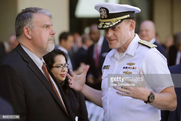 National Counterterrorism Center Director Nicholas Rasmussen talks with National Security Agency Director Admiral Michael Rogers before the...