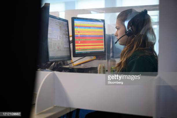 A National Covid Centre call handler South Central Ambulance Service operated by the South Central Ambulance Service NHS foundation trust sits behind...