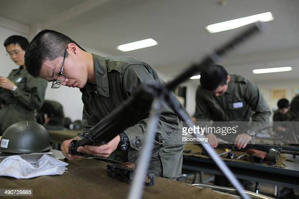 National Defense Academy of Japan cadets dismantle and reassemble rifles during a class at the NDA campus in Yokosuka Kanagawa Prefecture Japan on...