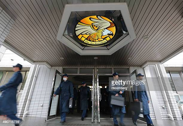 National Defense Academy of Japan cadets leave their barracks as they prepare to march to class at the NDA campus in Yokosuka Kanagawa Prefecture...