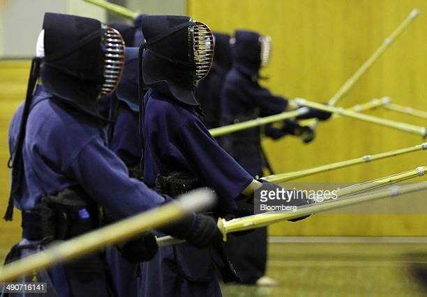 National Defense Academy of Japan cadets take part in Kendo the Japanese martial art of bamboo sword fighting during extracurricular activities at...
