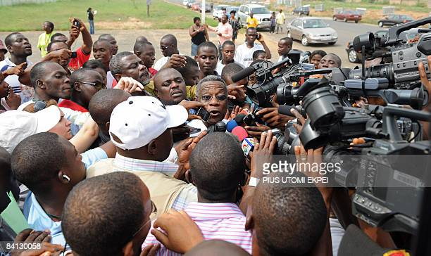 National Democratic Congress' presidential candidate John Attah Mills speaks after casting his vote at a polling station in Accra on December 28 2008...