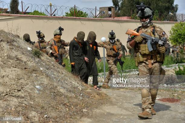 National Directorate of Security forces escort alleged Taliban fighters before they are presented to the media following an operation in Nangarhar...