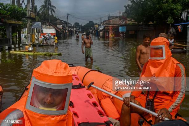 National Disaster Response Force personnel on inflated boats carry out rescue operations in the flood hit city of Amta in the Howrah district about...