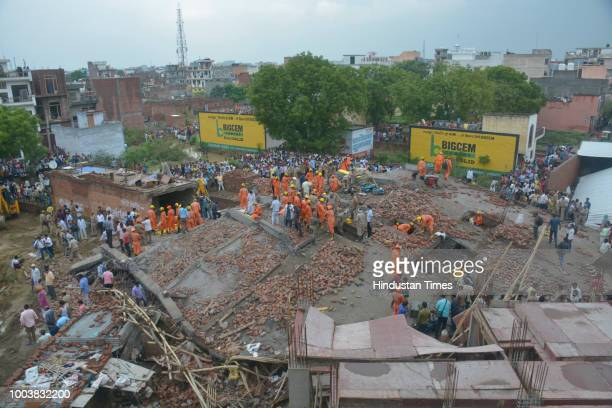 National Disaster Response Force seen carrying the rescue operation after an underconstruction building collapsed in Ghaziabad killing at least one...