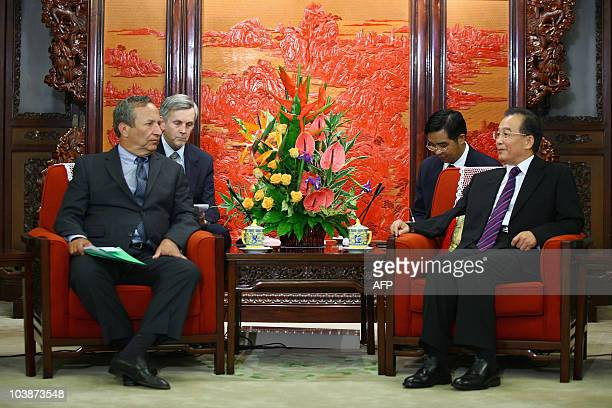 National Economic Council chairman Larry Summers speaks to Chinese Premier Wen Jiabao during their meeting in Beijing on September 7, 2010. China on...