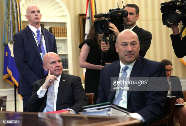 National Economic Council Director Gary Cohn and National Security Adviser H R McMaster sit in during a phone call between US President Donald Trump...