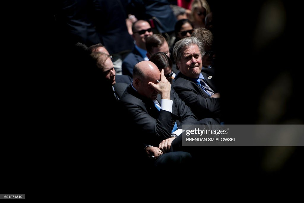 National Economic Council Director Gary Cohn (L) and strategist Steve Bannon wait with others to hear US President Donald Trump announce the US will withdraw from the Paris accord in the Rose Garden of the White House on June 1, 2017 in Washington, DC. 'As of today, the United States will cease all implementation of the non-binding Paris accord and the draconian financial and economic burdens the agreement imposes on our country,' Trump said. / AFP PHOTO / Brendan Smialowski